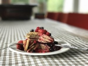 oat banana flaxseed pancake stack with berries